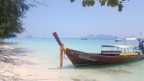 Longboat in Thailnad. Sea sand beach Royalty Free Stock Image