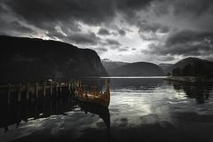 Longboat - viking`s wooden boat on Norddalsfjorden in middle Norway stock image