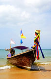 Longboat At Your Service Royalty Free Stock Photo
