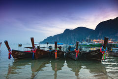 Longboats at sunset on Phi Phi royalty free stock image