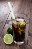 Longdrink. Cola with Rum and Lime in a Longdrink glass royalty free stock photography