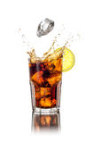 Longdrink with ice cubes and splash. A longdrink with ice cubes and splash royalty free stock images