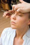 Longer lashes. In salon. Stylist working on a client Royalty Free Stock Photos