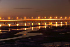 The worlds longbridge at night. Light on the bridge, the reflection in the water of the wetland Royalty Free Stock Photos
