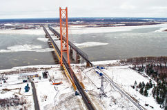 The longest cable-stayed bridge over the river ice snow winter Siberia spring Stock Photography
