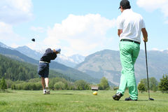 Longest Drive 1. Golf player watching another golfer on the tee stock photos