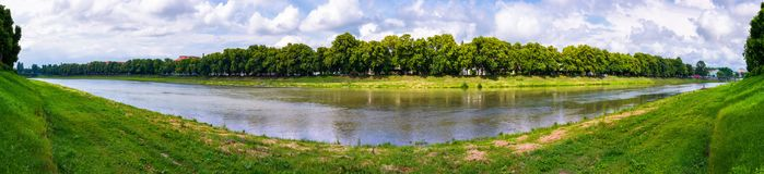 Longest european linden alley in Uzhgorod panorama. Panorama of longest linden alley in europe. Summer landscape on the river embankment in Uzhgorod, Ukraine Royalty Free Stock Image