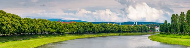Longest european linden alley in Uzhgorod. Longest linden alley in europe. Summer landscape on the river embankment in Uzhgorod, Ukraine Royalty Free Stock Photography