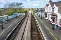 The longest place name of the UK, llanfairpwllgwyngyllgogerychwyrndrobwllllantysiliogogogoch on the public train station.  stock photo