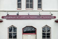 The longest place name of the UK, llanfairpwllgwyngyllgogerychwyrndrobwllllantysiliogogogoch on the public train station.  royalty free stock photography