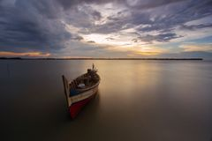 Boat at muara beting beach, bekasi indonesia. Longexposure capture, boat object, sunset, ocean stock photos