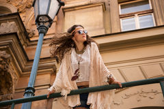 Longhaired bohemian girl with sunglasses near old town streetlig Royalty Free Stock Image