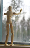Longing. Artist manikin looking out the window longingly Royalty Free Stock Photo