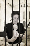 Longing behind bars Stock Photos