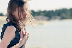 Longing woman. Beautiful young woman holds a heart in his hand royalty free stock photos