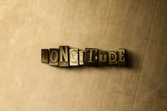 LONGITUDE - close-up of grungy vintage typeset word on metal backdrop. Royalty free stock illustration.  Can be used for online banner ads and direct mail Stock Images