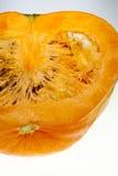 Longitudinal section of orange pumpkin on white background Royalty Free Stock Photos