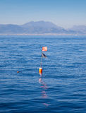 Longliner and trammel net buoy with flag pole Royalty Free Stock Photo