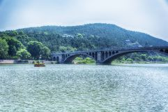 Longmen Bridge and Yi River Luoyang China. The longmen grotto scenic area in Luoyang China near the Yi River located in Henan Province stock photography