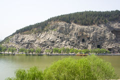 The Longmen Grottoes. With Buddha's figures are located on both banks of the Yi River, near Luoyang City, Henan province, China. Protected by UNESCO Royalty Free Stock Images