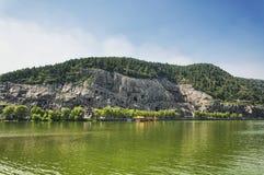 Longmen grottoes scemic area and Yi River Luoyang China. The longmen grottoes scenic area in Luoyang China near the Yi River located in Henan Province stock image