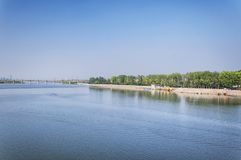 Longmen grottoes scenic area and Yi River Luoyang China. Longmen Grottoes scenic area  in Luoyang China in Henan province over the yi river on a sunny day stock images