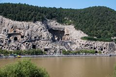 Longmen Grottoes. The Longmen Grottoes, which with the Dunhuang Grottoes in Gansu, Yungang Grottoes in Shanxi are ancient Buddhist grotto art in China and said Stock Images