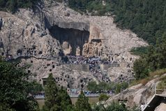 Longmen Grottoes. The Longmen Grottoes, which with the Dunhuang Grottoes in Gansu, Yungang Grottoes in Shanxi are ancient Buddhist grotto art in China and said Stock Photos