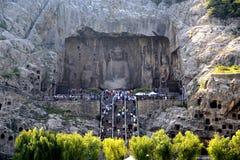 Longmen grottor, Dragon Gate Grottoes, i den Luoyang staden Royaltyfria Foton