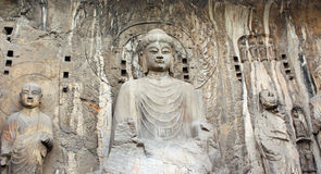 Longmen grottor med Buddha staty Arkivbilder