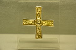 Longobard golden cross. With a central design of a deer exhibited in the archeological museum of Cividale del Friuli (Italy Stock Photography