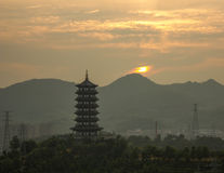 Longquan Pagoda at sunrise on a cloudy day royalty free stock image