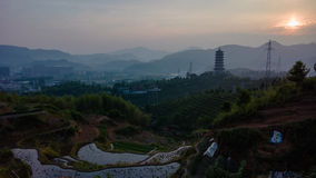 Longquan Pagoda at sunrise with rice terraces stock photos