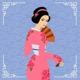 Longs cheveux de belles femmes du Japon avec la conception rose de robe Image stock
