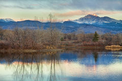 Longs Peak from Golden Ponds. A sunrise view of Longs Peak at golden ponds in Longmont Colorado, Boulder County Stock Photo