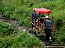 Longsheng, China: Porters Carrying Sedan Chair Royalty Free Stock Photo