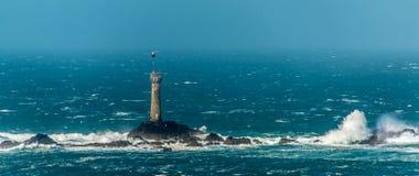Longships-Leuchtturm rationiert Lieferung Stockbilder