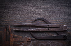 Longstanding calipers on vintage wooden background construction Royalty Free Stock Images
