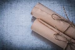 Longstanding paper scrolls on scratched metallic Royalty Free Stock Images