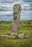 The Longstone/Long Tom near Minions, Cornwall UK. The Longstone or Long Tom is a medieval wayside cross that stands just to the south of a road that runs Stock Images