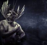 Longsword, Wild Warrior with huge metal sword. Wild Warrior with huge metal sword Stock Photo