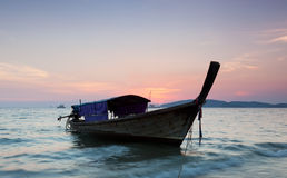 Longtail against a sunset. Royalty Free Stock Image