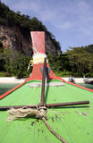 Longtail anchor krabi thailand. Longtail boat approcahing beach in krabi thailand royalty free stock photos