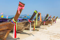 Longtail boast at the tropical beach. Longtail boat at the tropical beach of Poda island in Andaman sea, Thailand Royalty Free Stock Image