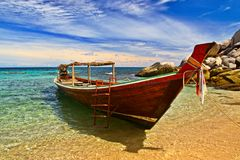 Longtail boat. In tranquil bay royalty free stock photography