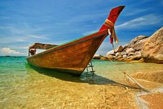 Longtail Boat. Anchored at a beach stock photo