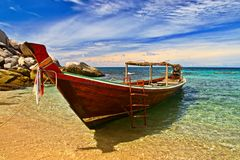 Longtail boat. In tranquil bay stock photo