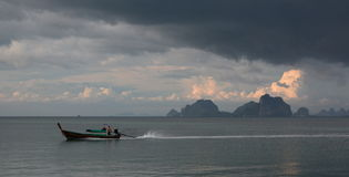Longtail boat against stormy sky. Koh Mook. Thailand Stock Photography