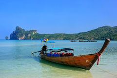 Longtail boat anchored at Ao Loh Dalum beach on Phi Phi Don Isla. Nd, Krabi Province, Thailand. Koh Phi Phi Don is part of a marine national park Royalty Free Stock Photo