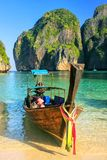 Longtail boat anchored at Maya Bay on Phi Phi Leh Island, Krabi. Province, Thailand. It is part of Mu Ko Phi Phi National Park royalty free stock photo